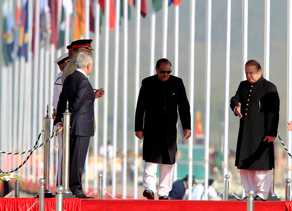 Prime Minister Nawaz Sharif (R) and President Mamnoon Hussain (C) arrive to attend the Pakistan Day military parade in Islamabad. PHOTO: REUTERS