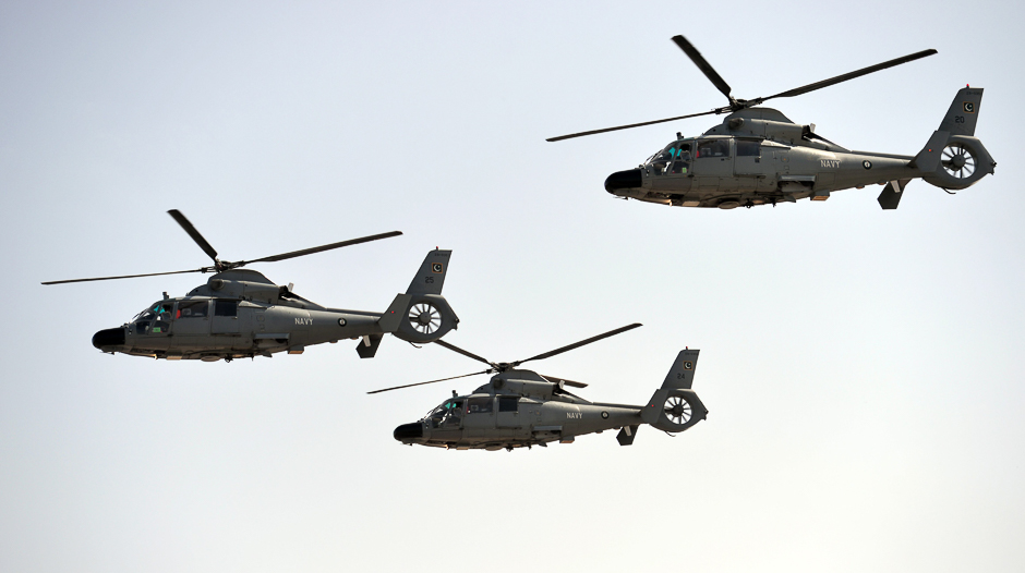 Navy helicopters fly past during a Pakistan Day military parade. PHOTO: AFP