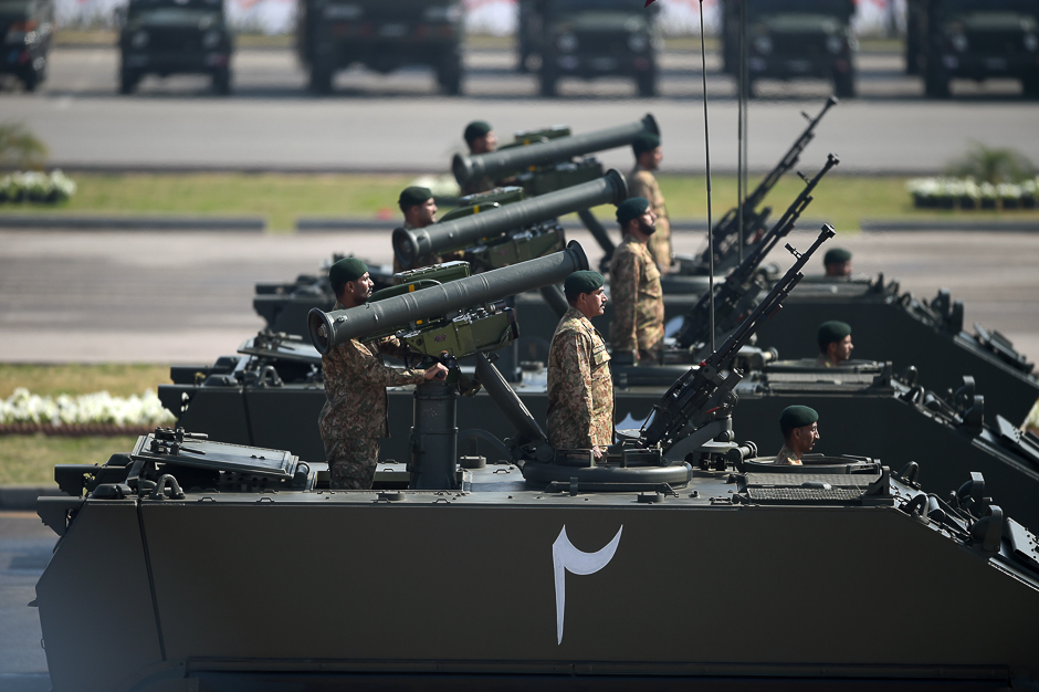 Tank crews steer their vehicles during the Pakistan Day military parade in Islamabad. PHOTO: AFP
