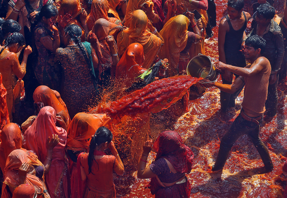 A man throws coloured water during
