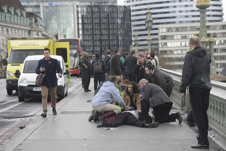 Injured people are assisted after the incident. PHOTO: REUTERS