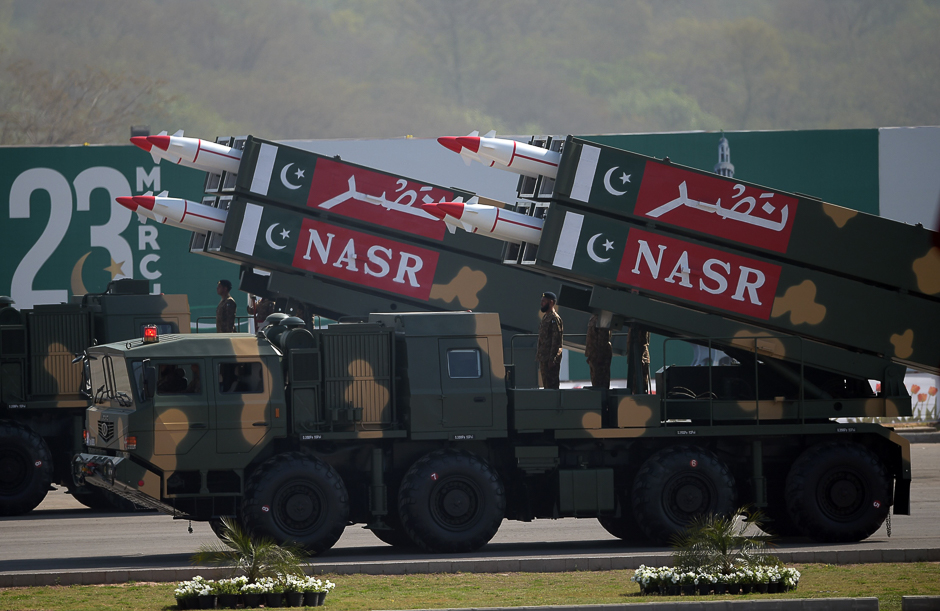 Military personnel stand beside short-range Surface to Surface Missile NASR during a Pakistan Day military parade in Islamabad. PHOTO: AFP