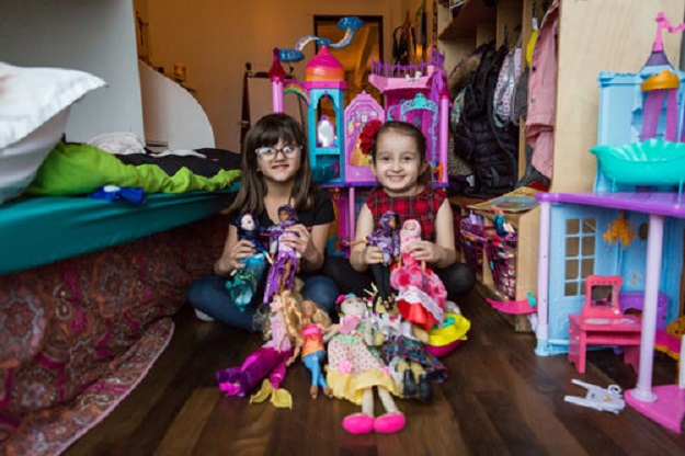 Salma Bokhari, age 5, and Grace Fetterman, also age 5, play with Graces dolls while their mothers, Gisele Fetterman and Safaa Bokhari, met to discuss plans for their new initiative, Hello Hijab. PHOTO: HELLO HIJAB