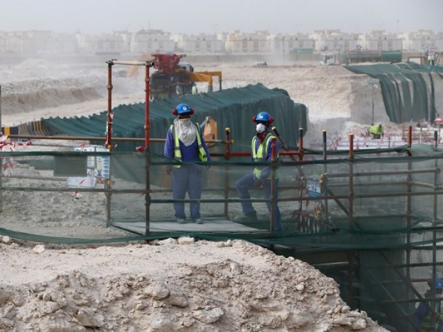 Foreign laborers work at the construction site of the al-Wakrah football stadium, one of the Qatar's 2022 World Cup stadiums. PHOTO: AFP
