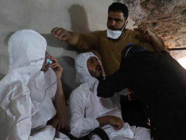 A man breathes through an oxygen mask as another one receives treatments, after what rescue workers described as a suspected gas attack in the town of Khan Sheikhoun in rebel-held Idlib, Syria April 4, 2017. PHOTO: REUTERS