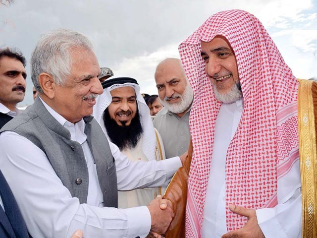 Khyber-Pakhtunkhwa Governor Iqbal Jhagra welcomes Imam-e-Kaa'ba at the Peshawar airport. PHOTO: PPI