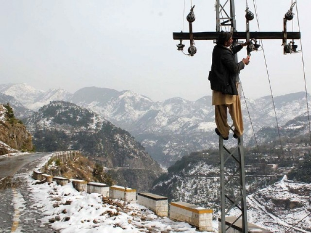 A PESCO worker fixing a power line. PHOTO: APP