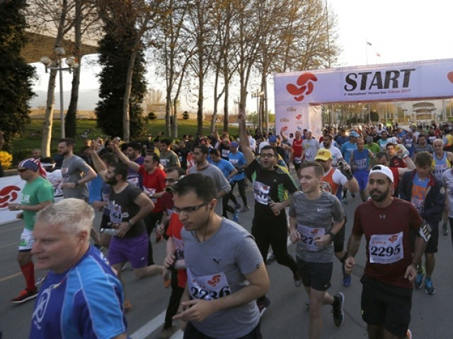 Local and foreign participants attend the first international Tehran marathon at Azadi Square in Tehran. PHOTO: AFP