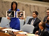 u-s-ambassador-to-the-united-nations-nikki-haley-holds-photographs-of-victims-during-a-meeting-at-the-united-nations-security-council-on-syria-at-the-united-nations-headquarters-in-new-york-city
