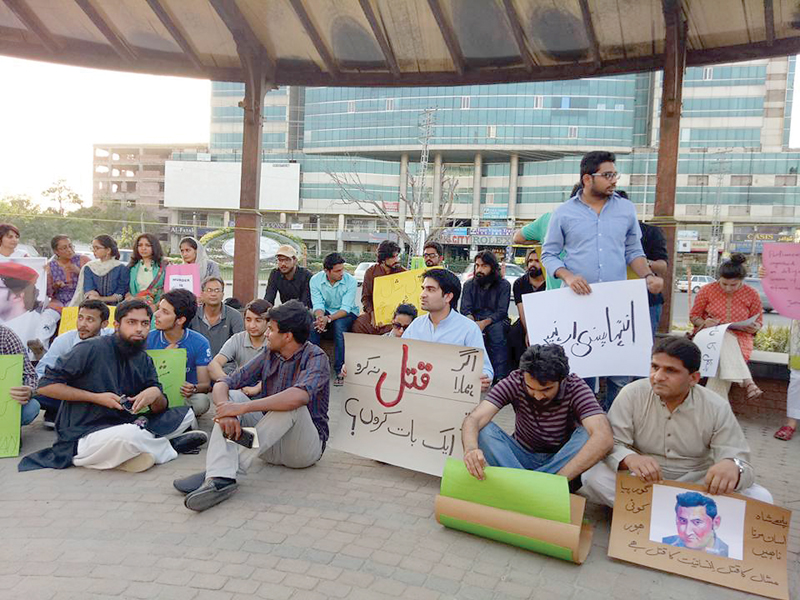 A number of people protest at Liberty Roundabout against the murder of Mashal Khan. PHOTO: EXPRESS