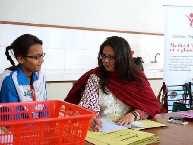 Dr Nuzhat Faruqui, founder of Ulphat, attending a medical camp at a school. PHOTO: TWITTER
