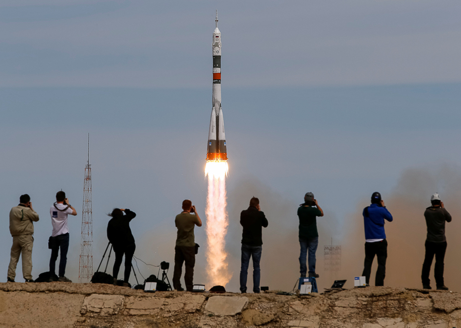 Photographers take pictures as the Soyuz MS-04 spacecraft carrying the crew of Jack Fischer of the US and Fyodor Yurchikhin of Russia blasts off to the International Space Station (ISS) from the launchpad at the Baikonur Cosmodrome, Kazakhstan. PHOTO: REUTERS