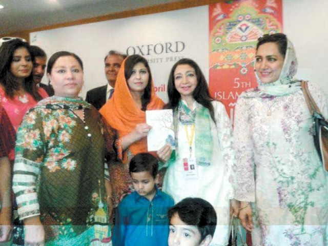 Poet Farzana Naz and her family standing among the dignitaries after the closing of NBF. PHOTO: EXPRESS