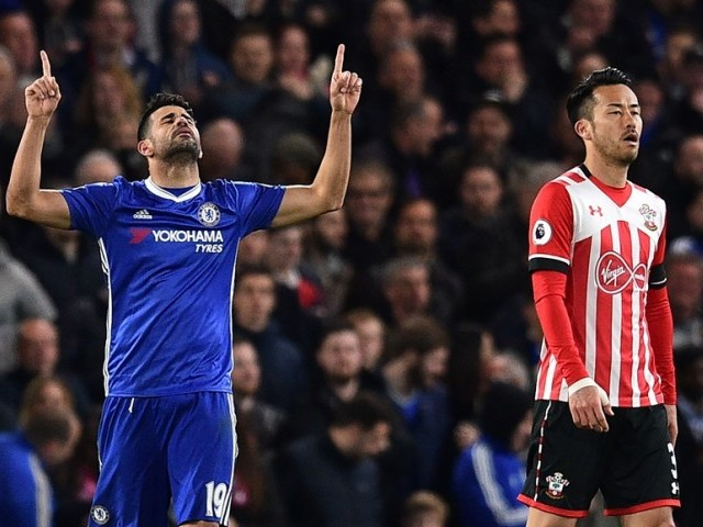 Chelsea's Brazilian-born Spanish striker Diego Costa celebrates after scoring their third goal during the English Premier League football match between Chelsea and Southampton at Stamford Bridge in London on April 25, 2017. PHOTO: AFP