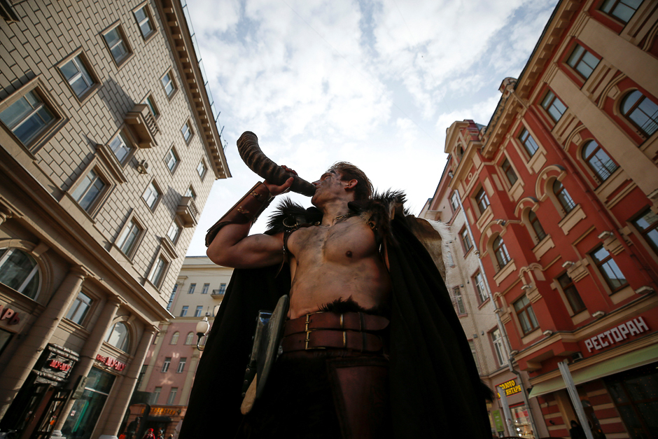 A man dressed in a Viking costume blows a horn on a street in central Moscow, Russia. PHOTO: REUTERS