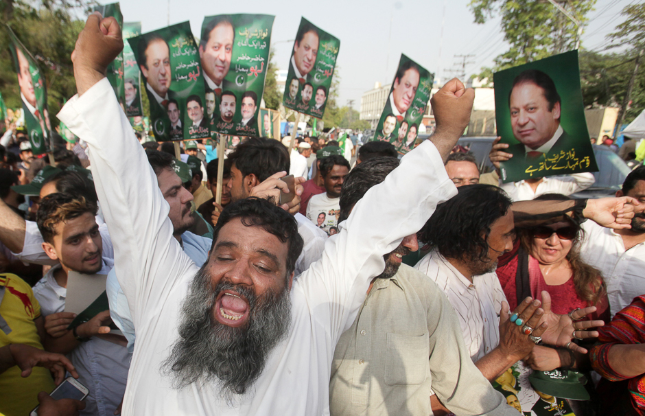 Supporters of Pakistan's Prime Minister Nawaz Sharif celebrate following the Supreme Court's decision in Lahore, Pakistan. PHOTO: REUTERS