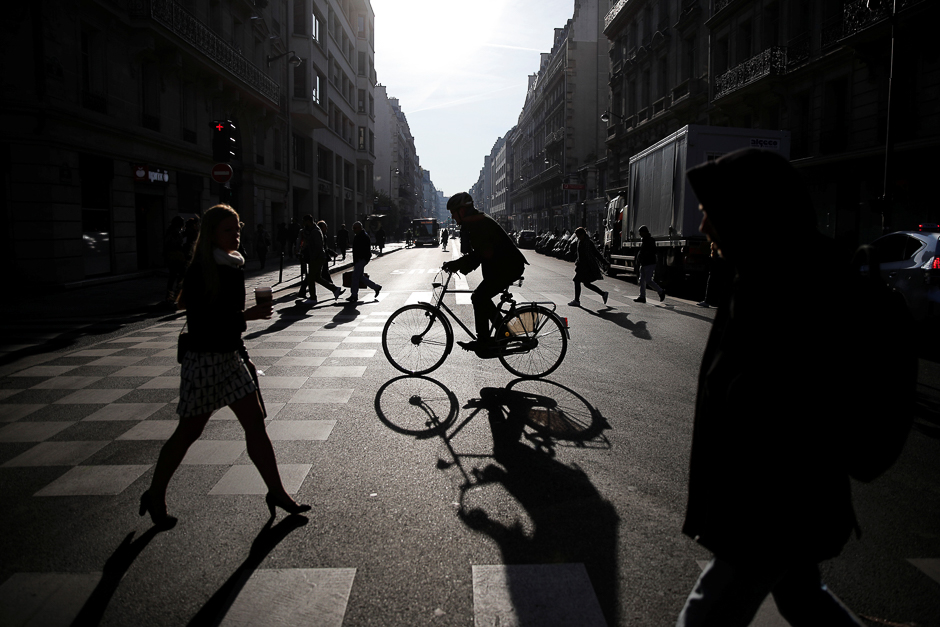 A man rides a bicycle on an early morning Spring day in Paris, France. PHOTO: REUTERS