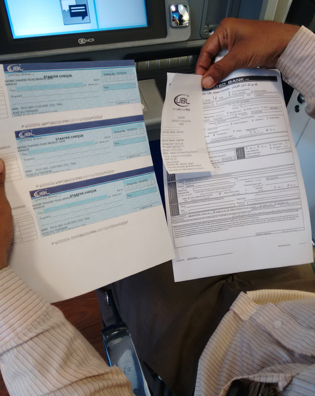 A copy of the filled account opening form and pre-activated cheques. PHOTO: UBL