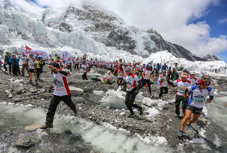 In this photograph released by the organisers of the Tenzing-Hillary Everest Marathon, runners participate in the world's highest marathon in the foothills of Mount Everest in the Solukhumbu district of Nepal. PHOTO: AFP