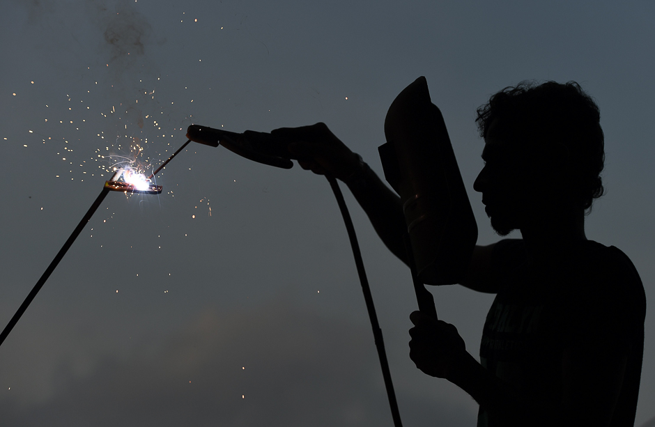 A Sri Lankan ironworker welds material at a building site in Colombo. PHOTO: REUTERS