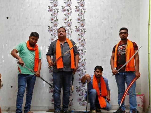 Hindu Yuva Vahini members pose inside the vigilante group's office in the city of Unnao India