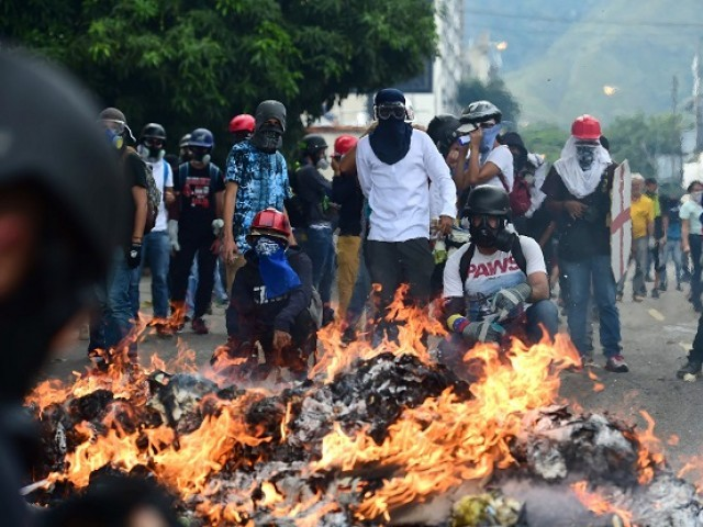 Protesters back on Caracas streets as death toll rises