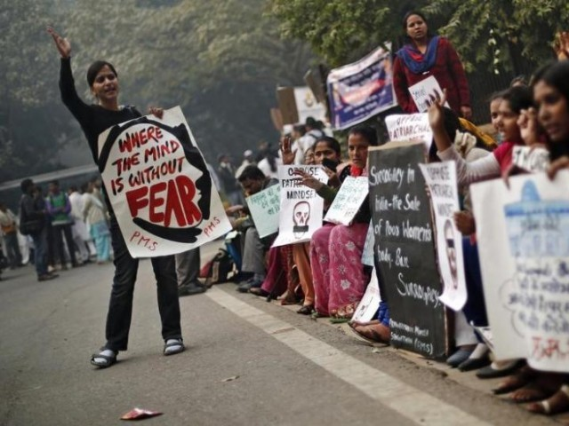 Protesters carry placards as they shout slogans during a protest to mark the first anniversary of the Delhi gang rape, in New Delhi PHOTO: REUTERS