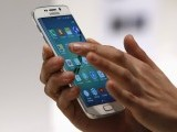a-hostess-displays-the-new-samsung-galaxy-s6-edge-smartphone-during-the-mobile-world-congress-in-barcelona-2-2-2-2