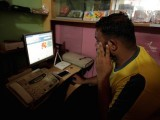 a-man-explores-social-media-on-a-computer-at-an-internet-club-in-islamabad-3