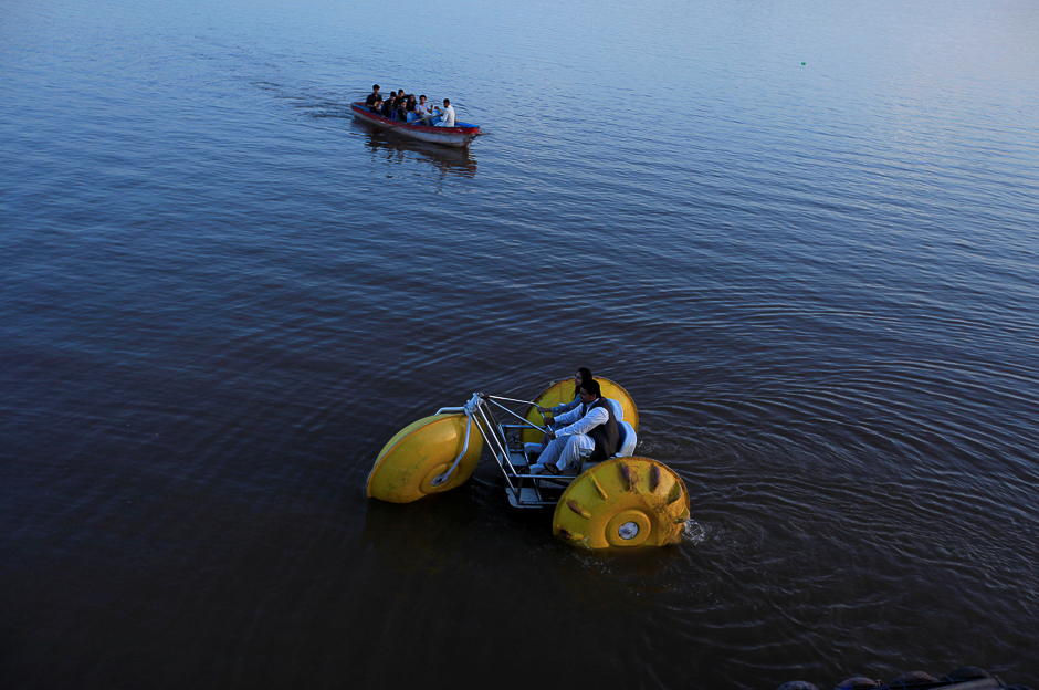 a-couple-rides-a-paddleboat-down-the-rawal-lake-in-islamabad-photo-reuters-2