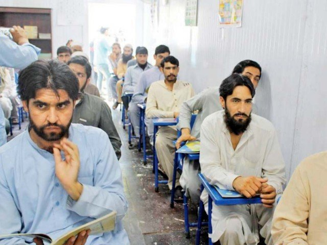Inmates attend a class in Peshawar jail. PHOTO: EXPRESS