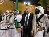 US President Donald Trump joins dancers with swords at a welcome ceremony ahead of a banquet at the Murabba Palace in Riyadh. PHOTO: AFP