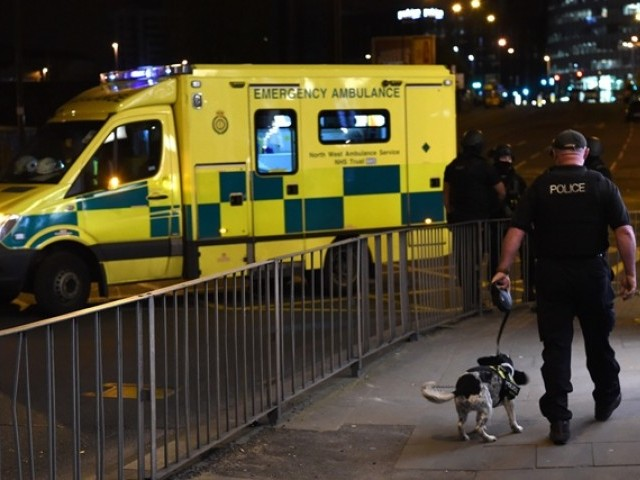 Emergency response vehicles arrive at the scene of a suspected terrorist attack during a pop concert by US star Ariana Grande in Manchester northwest England