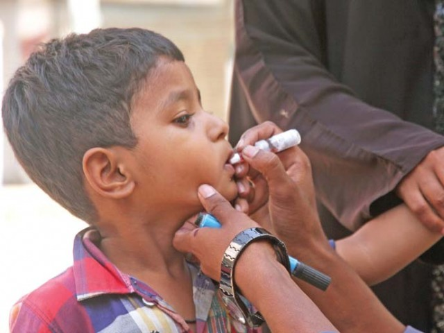 The five-day anti-polio campaign in all six districts of Karachi continues till May 27. PHOTO: EXPRESS