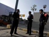 airport-security-force-asf-officials-stand-guard-near-the-main-gate-of-the-benazir-international-airport-in-islamabad-2
