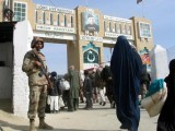 a-pakistani-soldier-keeps-guard-at-the-friendship-gate-crossing-point-at-the-pakistan-afghanistan-border-town-of-chaman