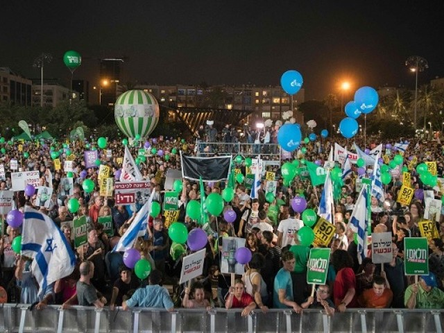 "A general view shows protesters gathering at a mass demonstration against 50 years of occupation titled ""Two States - One Hope"", on May 27, 2017 at the Rabin Square in the Israeli coastal city of Tel Aviv. PHOTO: AFP"