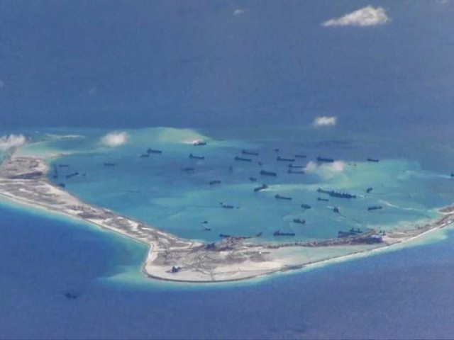 FILE PHOTO: Chinese dredging vessels are purportedly seen in the waters around Mischief Reef in the disputed Spratly Islands in the South China Sea in this still image from video taken by a P-8A Poseidon surveillance aircraft provided by the United States Navy May 21, 2015.  PHOTO: REUTERS