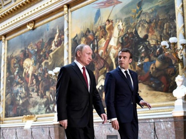 Macron criticizes Russian media for
