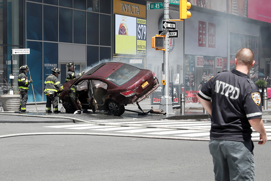 A vehicle that struck pedestrians in Times Square and later crashed is seen on the sidewalk in New York City, US. PHOTO: REUTERS