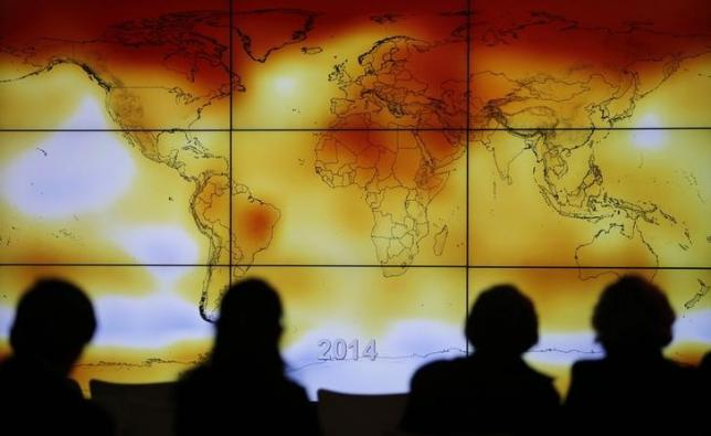 participants-looks-at-a-screen-projecting-a-world-map-with-climate-anomalies-during-the-world-climate-change-conference-2015-cop21-at-le-bourget-3-2-2-2-3-2-2-2