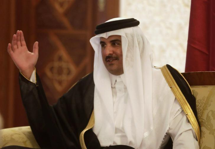 qatars-emir-hamad-al-thani-talks-with-algerias-senate-president-bensalah-upon-his-arrival-at-algiers-airport
