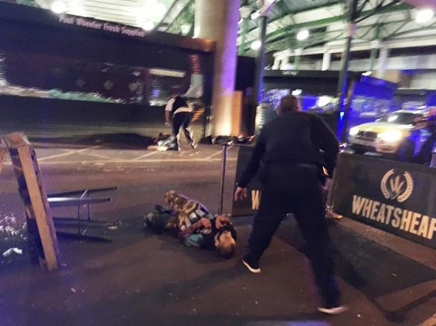 a-man-is-seen-on-the-ground-after-armed-police-officers-opened-fire-on-suspected-attackers-in-borough-market-london-2