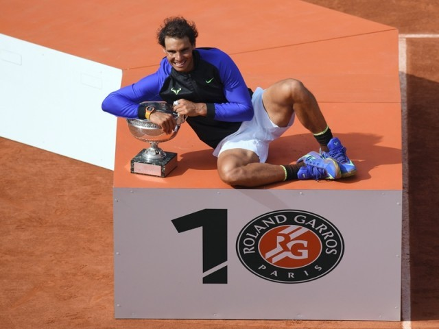 Spain's Rafael Nadal poses with the trophy after winning the men's final tennis match against Switzerland's Stanislas Wawrinka at the Roland Garros 2017 French Open on June 11, 2017 in Paris. PHOTO: AFP