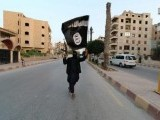 a-member-loyal-to-the-islamic-state-in-iraq-and-the-levant-isil-waves-an-isil-flag-in-raqqa-2-2-2-2-2-2-3-2-2-2-2-2