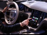 a-woman-touches-the-display-inside-a-volvo-car-during-the-media-day-ahead-of-the-84th-geneva-motor-show-at-the-palexpo-arena-in-geneva