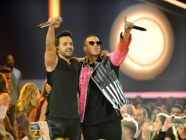 Luis Fonsi and Daddy Yankee perform onstage at the Billboard Latin Music Awards in April 2017.  PHOTO: AFP