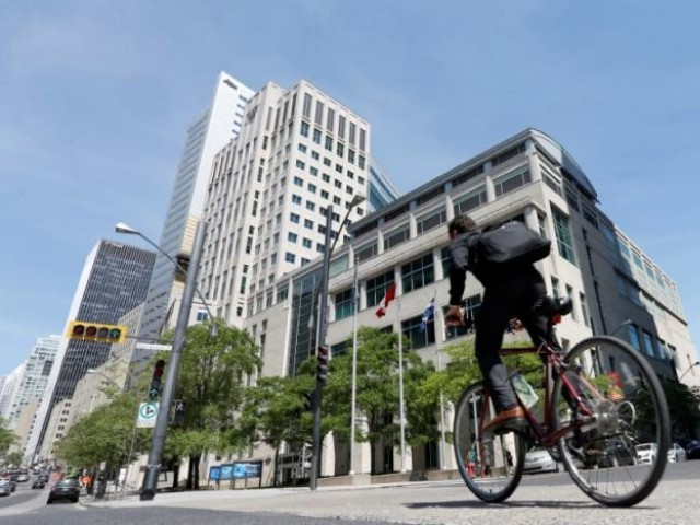 A man cycles past the International Civil Aviation Organization (ICAO) headquarters building in Montreal, Quebec, Canada June 15, 2017.  PHOTO: REUTERS