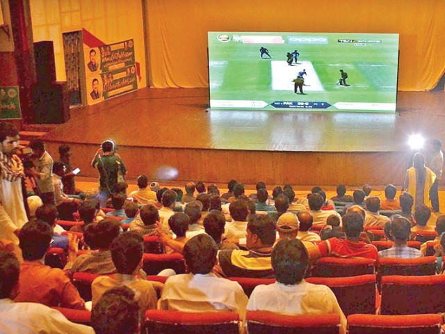 People watching the final of Champions Trophy at Arts Council, Multan. PHOTO: APP