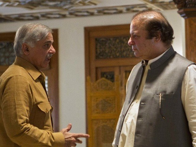 Prime Minister Nawaz Shairf in a conversation with his brother and Punjab Chief Minister Shehbaz Sharif. PHOTO: REUTERS / FILE